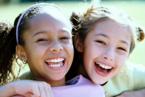 two young girls with beautiful smiles thanks to their children's holistic dentist in ballston spa